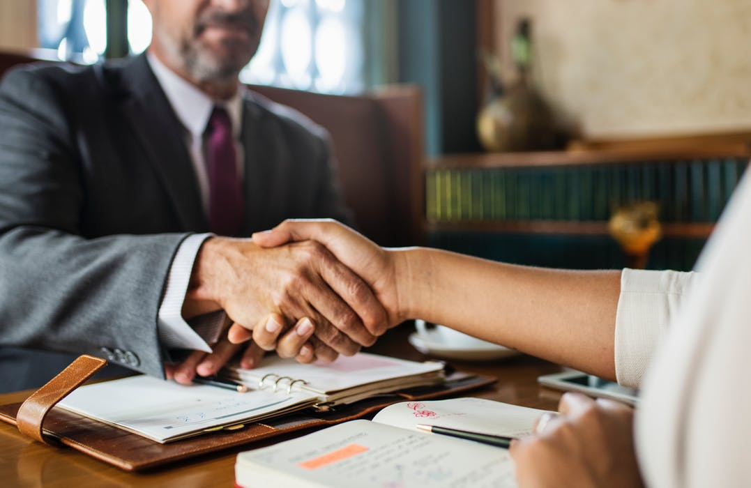 lawyer-client hand shaking