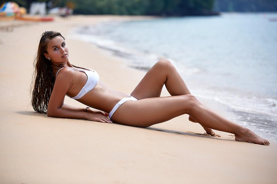 Sexy girl wearing a white minimal bikini