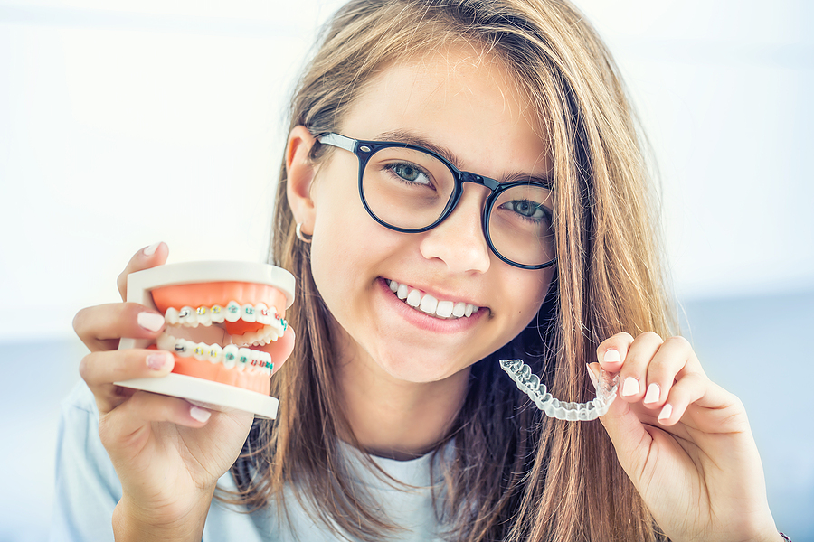 Woman showing her invisalign in Chatswood