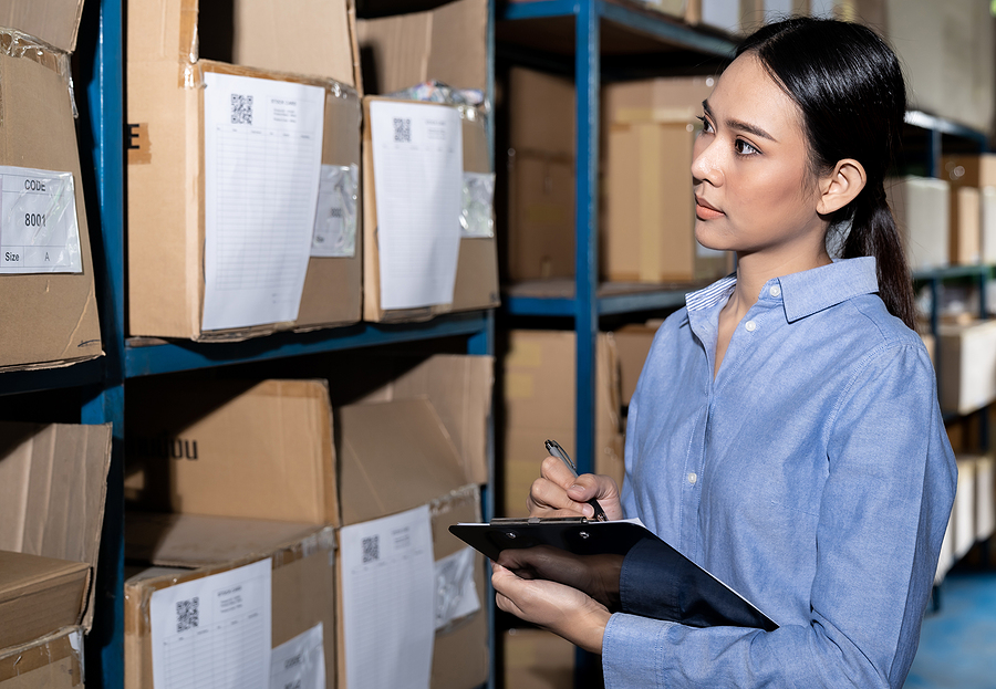 Woman working in a supply chain and logistics warehouse