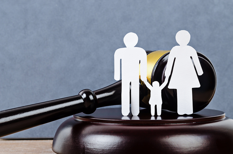A figure of a family and a gavel. Family law concept