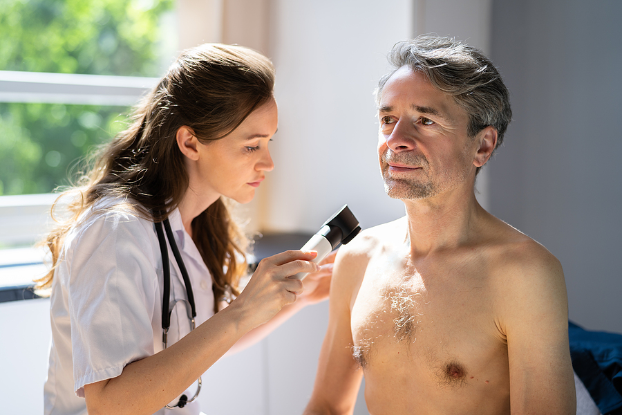 Old man being examined in a skin cancer clinic in Melbourne