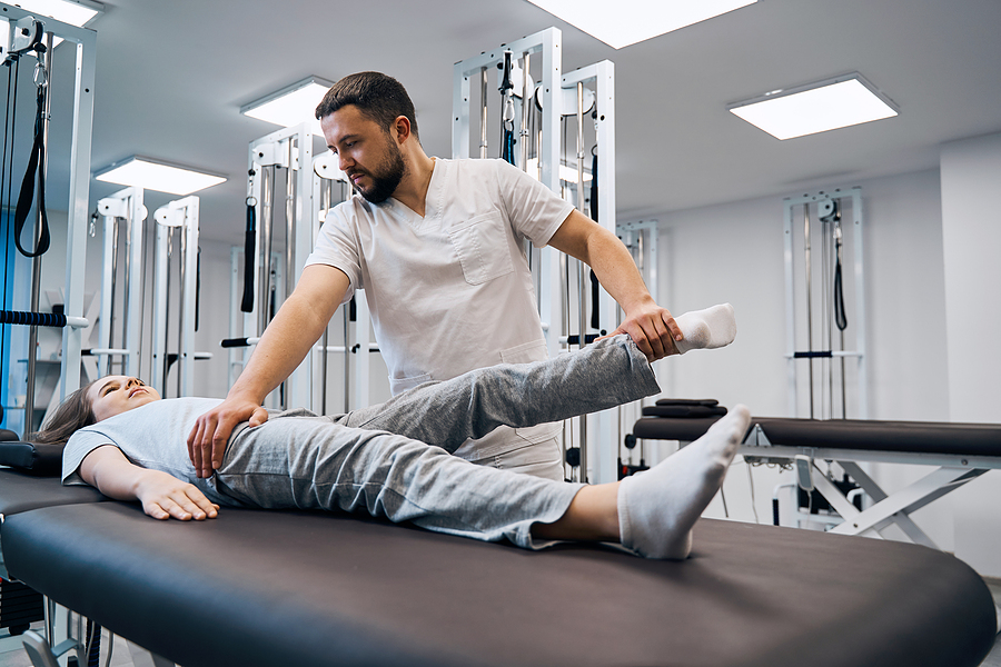 Norwest chiropractor treating a woman with sport's injury