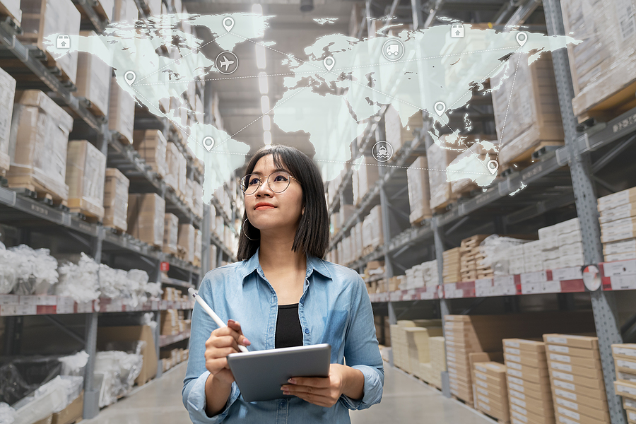 Female manager doing a reverse logistics inventory inside a warehouse